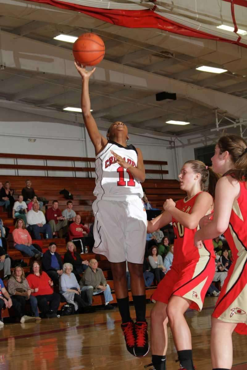 Lutheran's Nani Redford scores two points during her