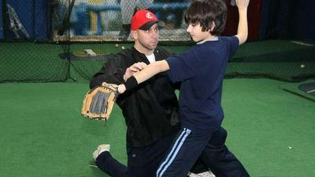 Fletch Adamo instructs a student at Play Like