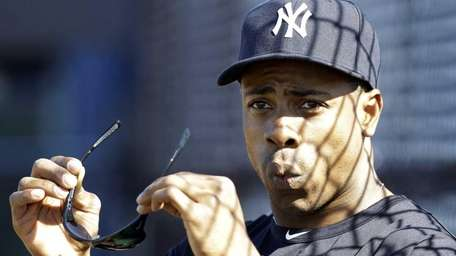 Yankees outfielder Curtis Granderson watches a teammate hit