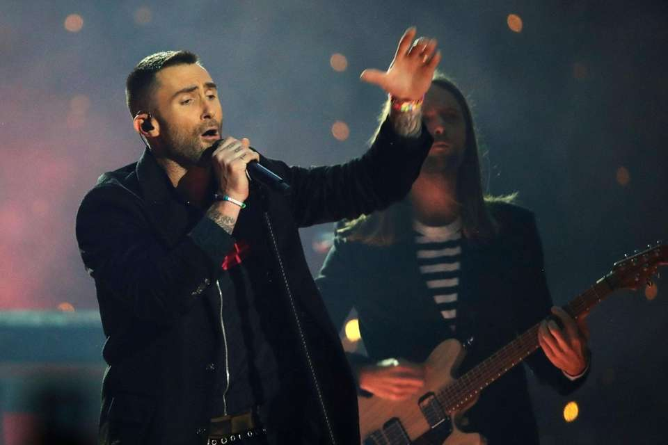 Adam Levine of Maroon 5 performs during halftime