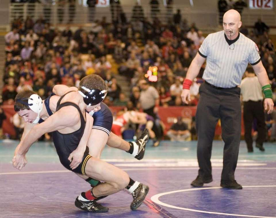 Commack's C.J. Labate, left, gets taken down by