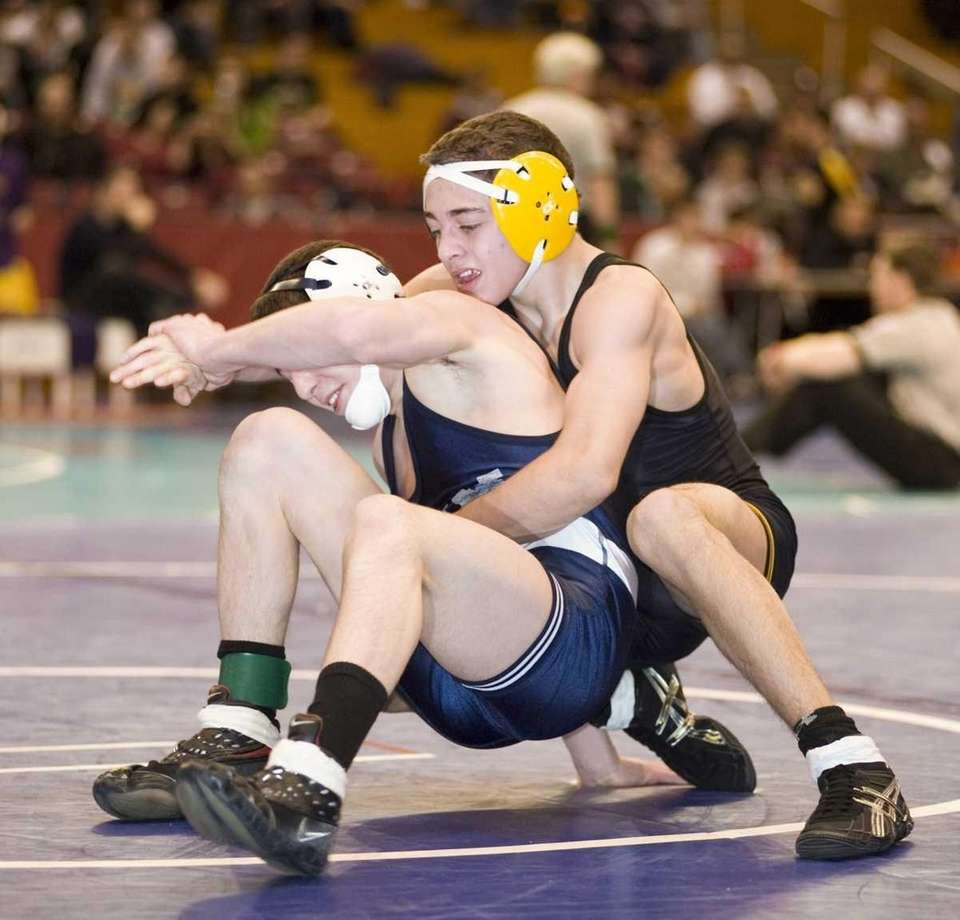 Commack's C.J. Labate, right, has a grip on
