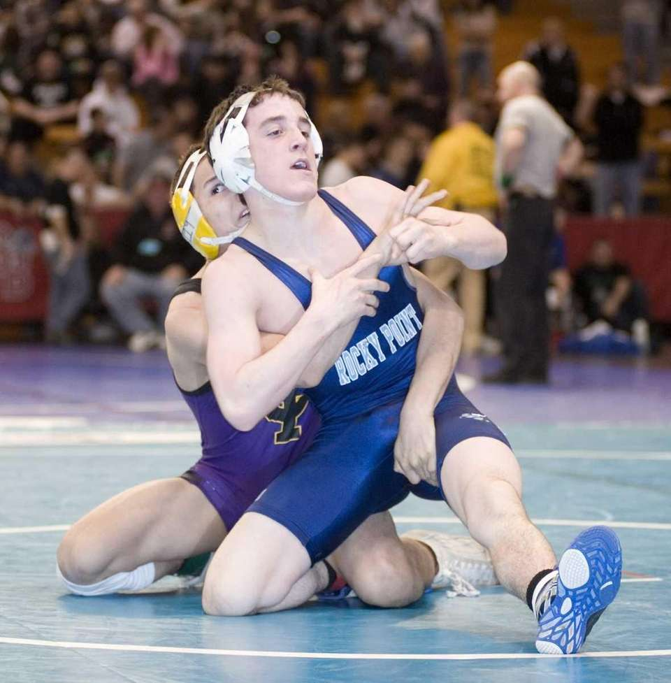 Central Islip's Giovanni Sanchez, rear, wrestles Rocky Point's
