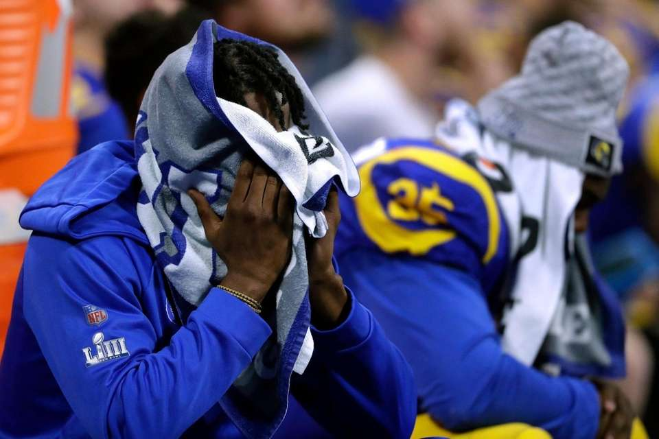 Los Angeles Rams players sit dejected on the