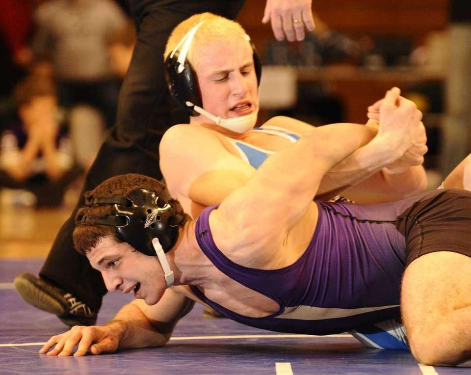 Hauppauge's Adam Lepkowsky, top, defeated Islip's Mike DiMartino,