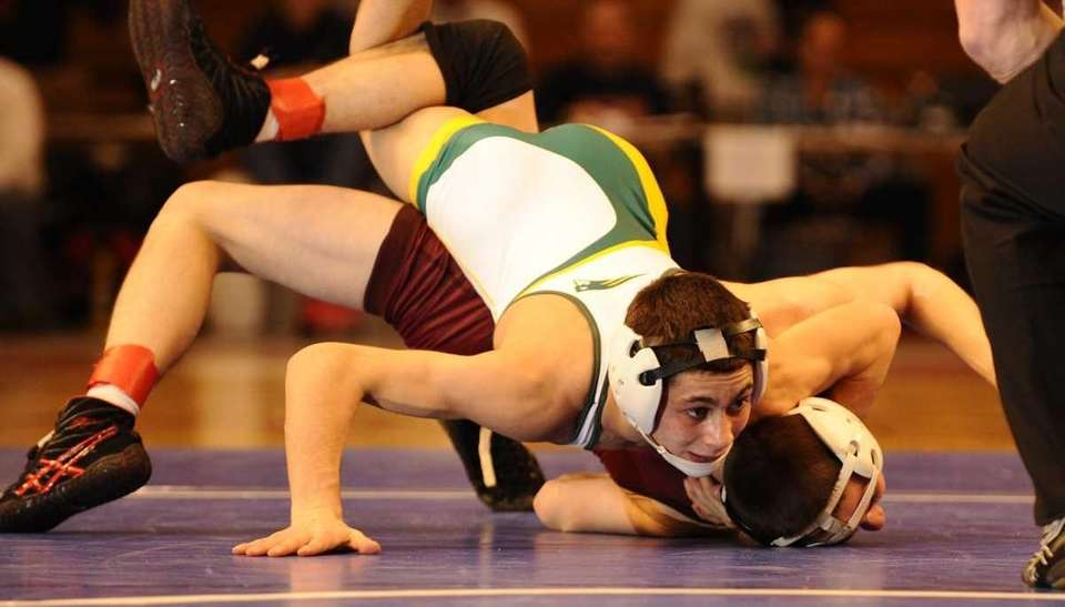 Ward Melville's Nick Piccininni, top, defeated Kings Park's
