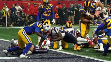 New England running back Sony Michel, center, scores