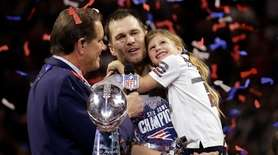 The Patriots' Tom Brady holds his daughter, Vivian,