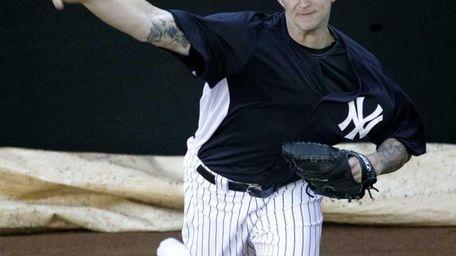 New York Yankees pitcher A.J. Burnett throws a