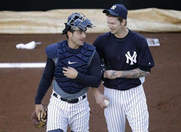 New York Yankees pitcher A.J. Burnett talks with