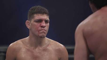 Nick Diaz, faces off with K.J. Noons in