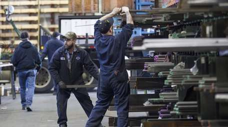 Laborers fill orders of machine grade steel to