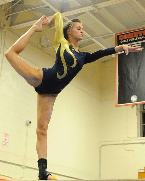 Bethpage junior Erin Roach performs her balance beam