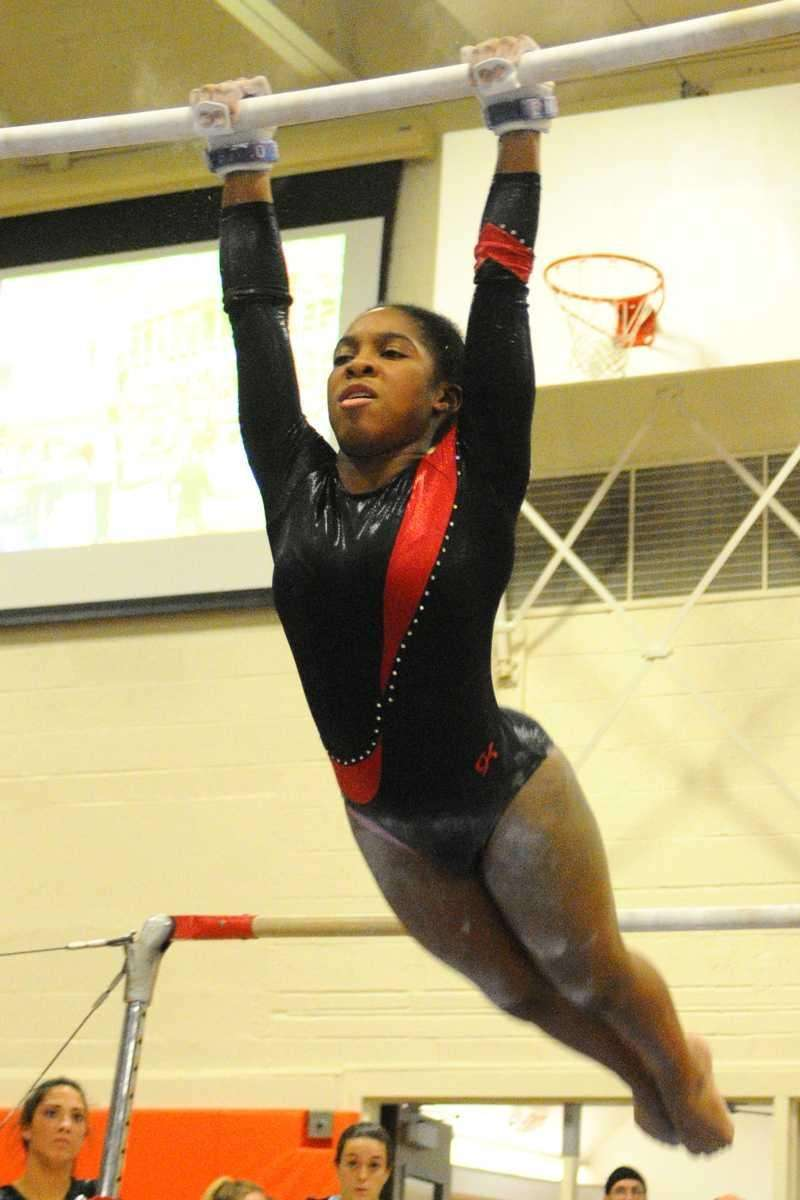 Sewanhaka's Corinne Alleyne performs her routine on the
