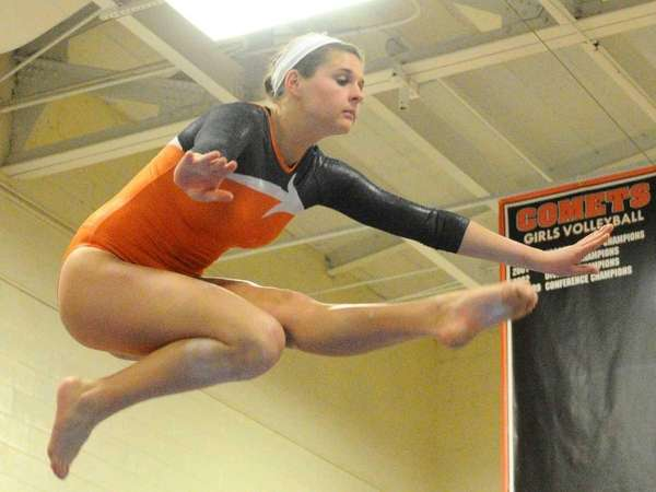 Hicksville's Lauren Cecco performs her balance beam routine