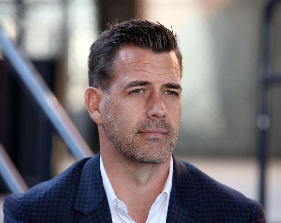 Mets General Manager Brodie Van Wagenen talks to