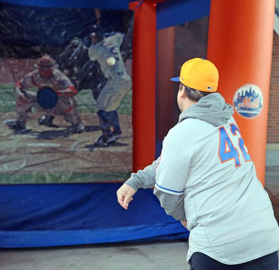 Fan throws against target during the Mets equipment