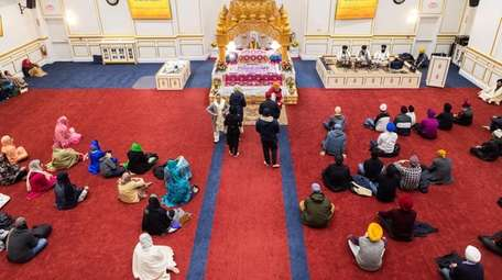 Worshippers attend an evening service led by Giani