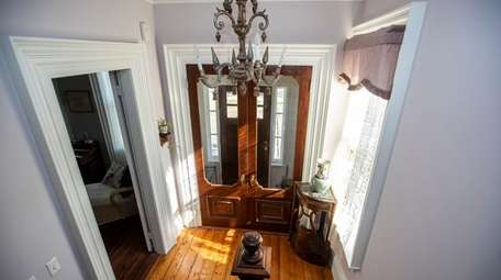 The entranceway with the original French doors of