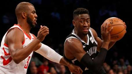 Caris LeVert of the Nets drives against Chris