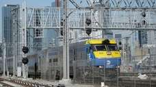A Long Island Rail Road train passes under