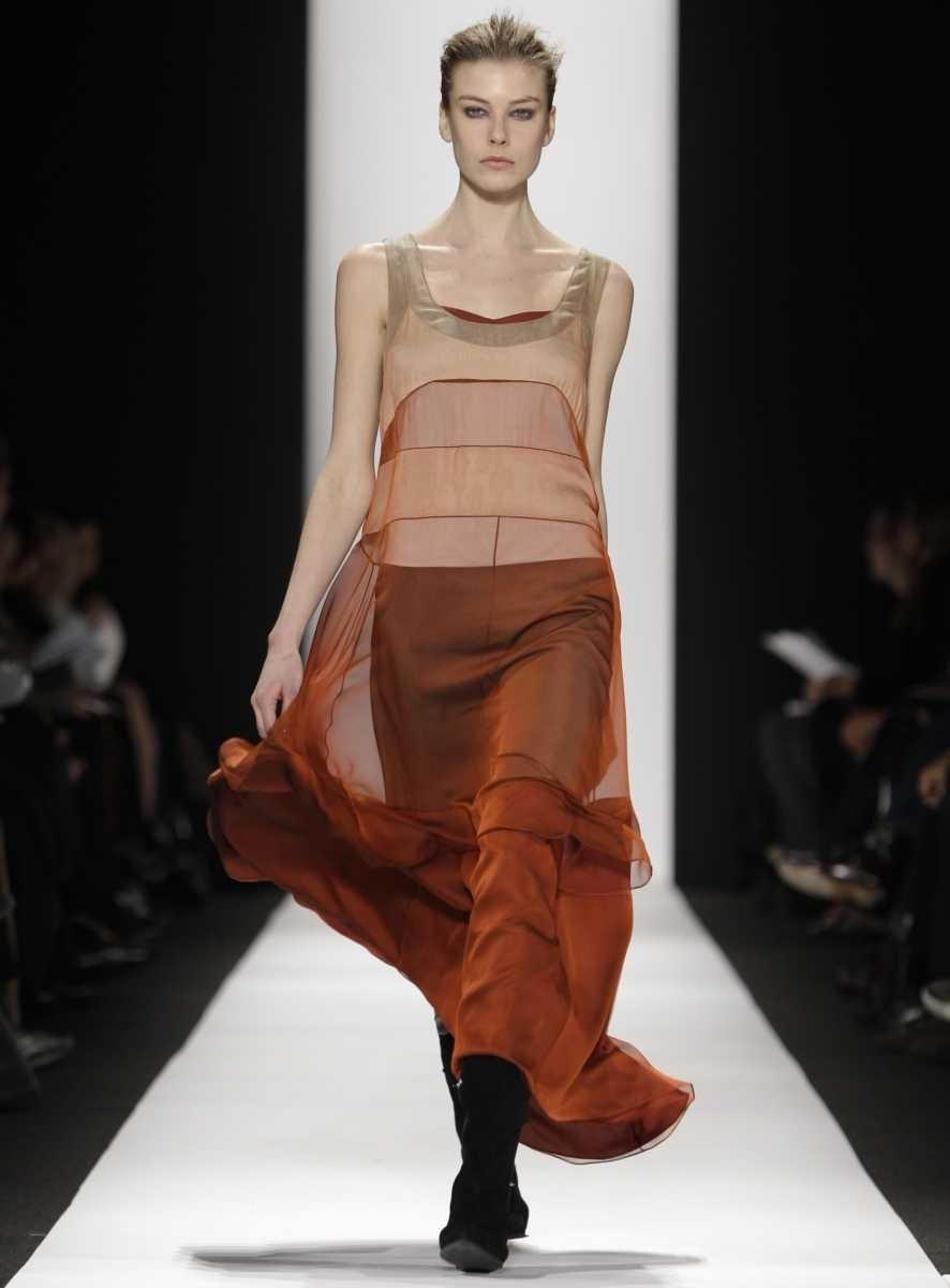 A model walks the runway at the Narciso