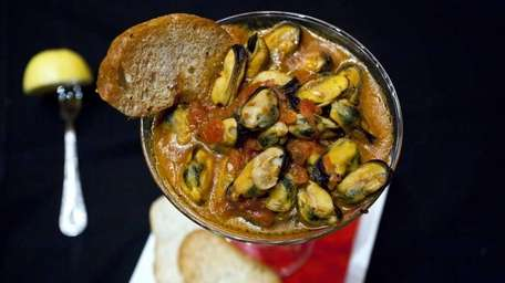 Prince Edward Island mussels are served