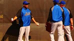 Mets reliever Francisco Rodriguez gestures during workouts in