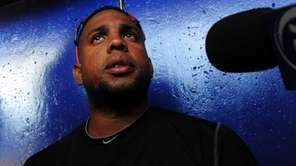 Pitcher Francisco Rodriguez talks to reporters in Port