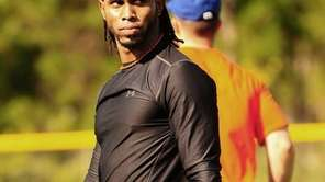 Jose Reyes looks on during workouts in Port