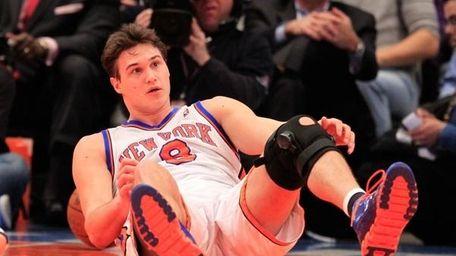 Danilo Gallinari of the New York Knicks falls