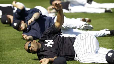 New York Yankees pitcher CC Sabathia stretches with