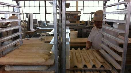 Peter Donovan prepares baguettes for the oven at