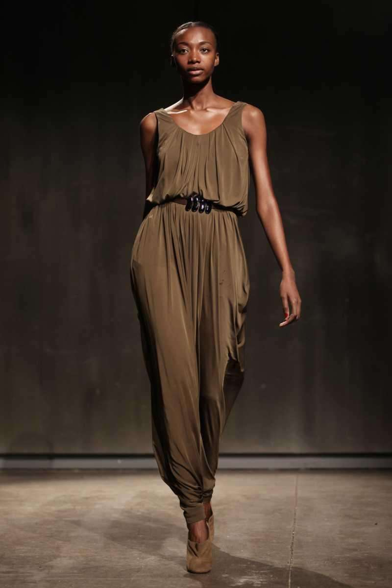 A chocolate silk dress is cinched at the