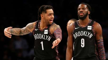 D'Angelo Russell #1 and DeMarre Carroll #9 of