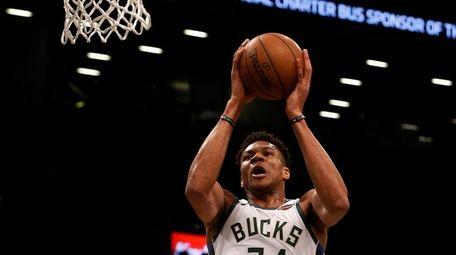 Giannis Antetokounmpo #34 of the Milwaukee Bucks goes