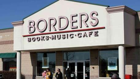 Customers walk out of a Borders bookstore that
