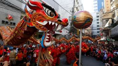 Dancers perform traditional lion and dragon dances in