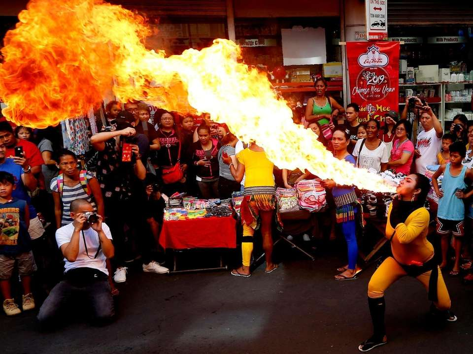 In this Tuesday, Feb. 5, 2019, photo, fire-eater
