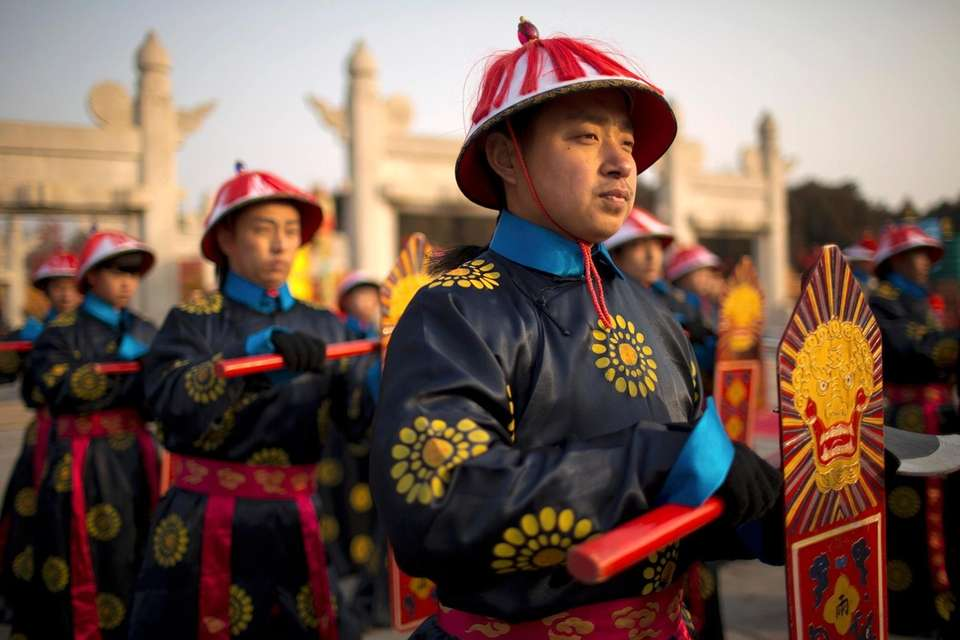 Performers stand during a Qing Dynasty ceremony in