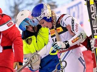 Lindsey Vonn reacts after crashing during the women's