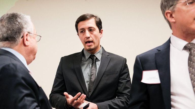 Ali Asmari, center, program manager of ULC Robotics'