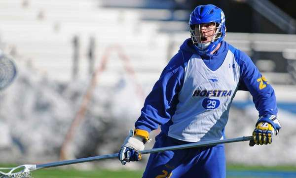 Mike Skudin plays defense during NCAA men's lacrosse