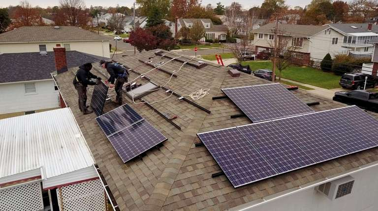Installation of solar panels on the roofs of