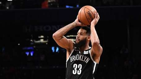 Nets forward Allen Crabbe shoots for a three-point
