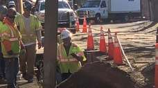 Workers dig up the recently repaved Locust Lane