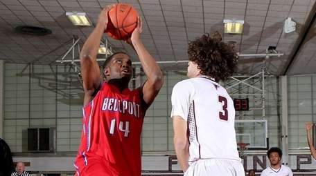 Jarell White of Bellport drives to the basket