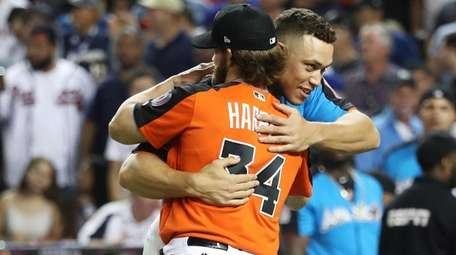 Aaron Judge of the Yankees hugs Bryce Harper