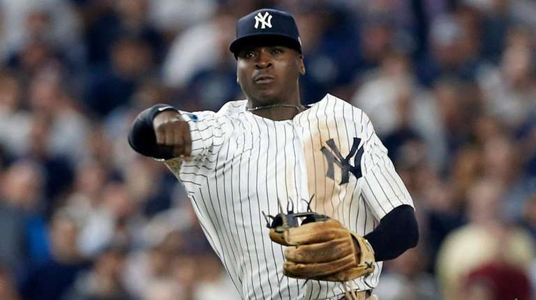 Didi Gregorius of the Yankees throws to first