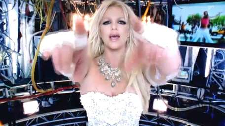 Britney Spears performs in her new music video